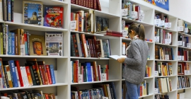 student at library browsing books
