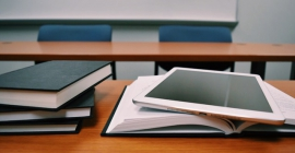 desk with tablet and books